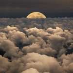 A Breathtaking Moon Hiding behind The Clouds